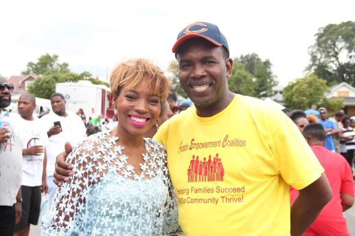 In addition to free haircuts, the Aug. 13 Austin Community Fest also featured numerous musical guests, free food and lots of fun. Rev. Ira Acree, Greater St. John's pastor (pictured with radio personality Sonya Blakey), touted the power of education in bettering the neighborhood.   Courtesy Greater St. John Bible Church