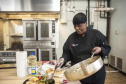 EMPOWERMENT SERVED FRESH: Patty Ringo prepares a quick lunch at Chicago Kitchen on Dec. 16. Ringo's catering enterprise, Katr2U, was named business of the month for December by the Leaders Network. | WILLIAM CAMARGO/Staff Photographer