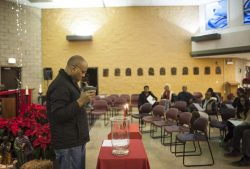 Vincent Guider lead the Kwanza celebration and gathering at St. Agatha church in North Lawndale on Wednesday afternoon December 28, 2016.
