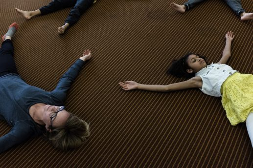Instructor Erin Connor, left, lays on the ground along with other fellow students in a loose yoga position, on Saturday, Feb. 4, 2017, signifying the end of A House in Austin's Yoga Class. A House in Austin is a local non-for-profit organization, is starting a monthly workshop where members of the community can learn healthy eating habits and yoga, through seminars.