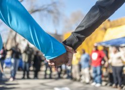 People join in prayer before starting a block party in which Marseill Jackson called upon, to help halt violence on the 4400 block of W. Monroe on the west side of Chicago on Saturday February 18, 2017.