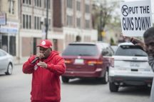 Chris Burton a member of Stop the Violence in the Austin neighborhood of Chicago, pumps up the neighborhood on Wednesday April 19, 2017. Stop the Violence a group in the Austin neighborhood that works as a rapid response group when ever shooting occur on the west side. The group has gathered on Wednesday afternoon on the corner of Lake and Corcoran where a shooting occurred two weeks ago.