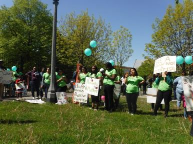 Community members march during a May 12 peace rally organized by numerous West Side organizations, including a group of mothers. | Igor Studenkov/Contributor