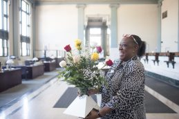 Rosie Moses receives flowers as a gift for all the years she works at Austin Bank which closed over the weekend on June 1, 2017.
