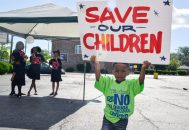 Chad Perez, (top left) 3, of Chicago, holds up a sign on Saturday, July 29, 2017 during the 29th annual Say No To Drugs and Violence Parade and Back to School Rally in Chicago's Austin neighborhood. | Alexa Rogals/Staff Photographer