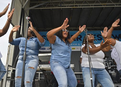Members of Joshua's Troop since and dance on stage on Saturday, Aug. 26, during Ald. Jason Ervin's Summer Festival at Marshall High School Campus Park in Chicago's Austin neighborhood. | ALEXA ROGALS/Staff Photographer