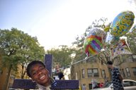 A cross with birthday balloons and a photo of Elijah Sims sits at the corner on Wednesday, Aug. 30, during a remembrance celebration and barbecue for Sims at the corner of Lotus Avenue and Quincy Street in Chicago's Austin neighborhood. | ALEA ROGALS/Staff Photographer