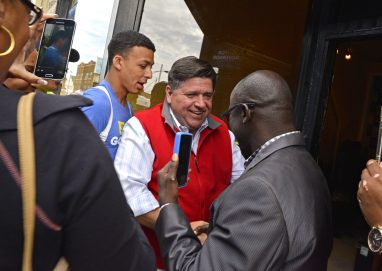 Outreach: Gubernatorial candidate J.B. Pritzker shakes hands with attendees on Sept. 2, during the opening of his campaign office at 5847 W. Chicago Ave. in Austin. | ALEXA ROGALS/Staff Photographer