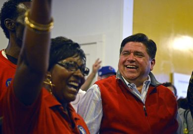 Outreach: Gubernatorial candidate J.B. Pritzker shakes hands with attendees on Saturday, during the opening of his campaign office at 5847 W. Chicago Ave. in Chicago's Austin neighborhood. | ALEXA ROGALS/Staff Photographer
