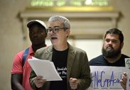Brant Rosen, of Evanston, introduces speakers on Friday, Sept. 22, during a call to action outside of the mayor Rahm Emanuel's office on the fifth floor of Chicago City Hall. | ALEXA ROGALS/Staff Photographer