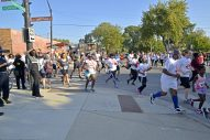 Power up! Runners turn down Mayfield Street on Saturday, Sept. 23, during the annual Austin P.O.W.E.R. of Life 5K Walk/Run in Chicago's Austin neighborhood. Story and more photos on page 4. | ALEXA ROGALS/Staff Photographer