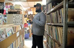 An employee looks through different records at the Out of the Past Records store. | ALEXA ROGALS/Staff Photographer
