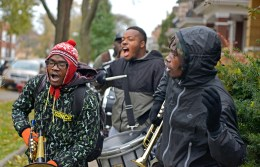 Not on their watch: Members of the Exodus adult marching band group perform while walking up and down the street on Friday, Nov. 17, during a Good Neighbor Campaign rally on Massasoit Avenue near Augusta Street in Austin. | ALEXA ROGALS/Staff Photographer
