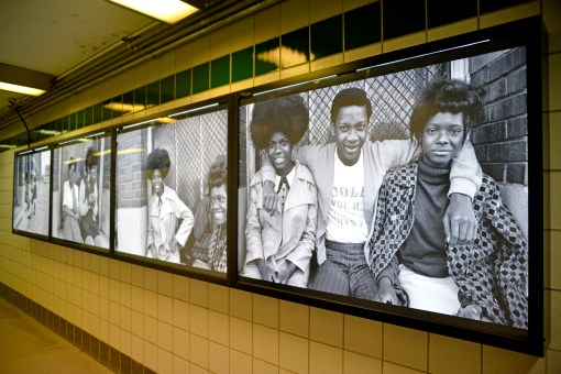 Dorrell Creightney's photographs hung on the wall at the L Green Line Central Station on Central and Lake Street in Austin. | ALEXA ROGALS/Staff Photographer