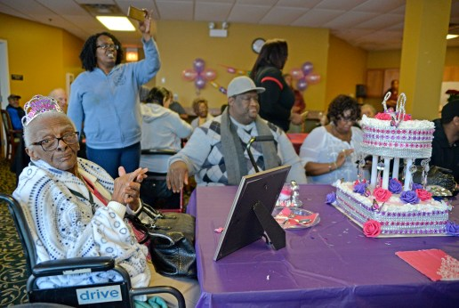 She's still here: Le'Etter Bryant, left, of Chicago, claps to music last Wednesday, during her 105th birthday party at the Heritage Woods of Chicago. | ALEXA ROGALS/Staff Photographer