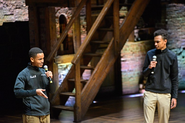 Providence St. Mel School students John Bonds III, left, and Erik Imathiu-Jones, perform a scene between Banneker and Jefferson last Wednesday, during the Hamilton Education Program at the CIBC Theatre on Monroe Street in downtown Chicago. | ALEXA ROGALS/Staff Photographer