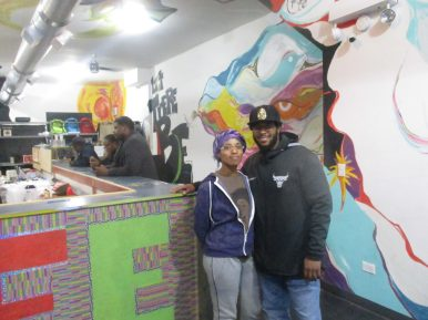 AT THE TABLE: Joe Black, right, and his wife, Tonya, who serves as LiFE's head chef, inside of LiFE restaurant as customers stop by during Chicago Black Restaurant Week. | IGOR STUDENKOV/Contributor