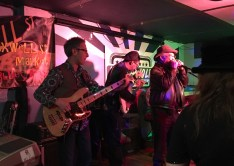 Singer Johnny Harper, guitar player Reggie, and bass player Lawrence Glasser at the April 18 Water Hole jam in memory of Sleepy Riley