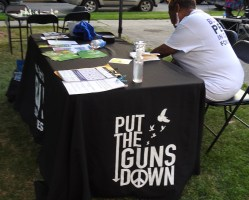 """Put the Guns Down"" table at Light in the Night, Hubbard Park."