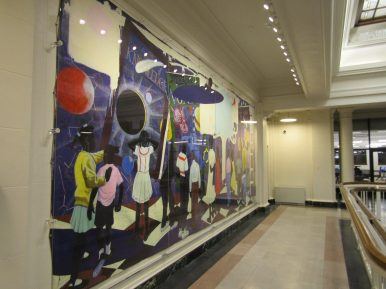 """Artist Kerry James Marshall's """"Knowledge and Wonder,"""" a painting the city contemplated selling to pay for the renovations before the public backlash forced it to reverse course, is back on display on the library's second floor. 