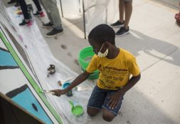 A young West Sider helps create an outdoor painting last year. | Alex Rogals