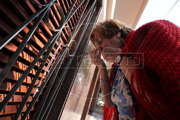 Marta Brett kisses a rosary she placed on the house where Jorge Mario Bergoglio lived in Buenos Aires, Argentina. Brett placed the symbol there to ask for help for her neighbor, who has leukemia. Bergoglio was elected in a surprise choice to be the new leader of the Roman Catholic Church, taking the name Francis I and becoming the first non-European pontiff in nearly 1,300 years. (Australfoto/Douglas Engle)
