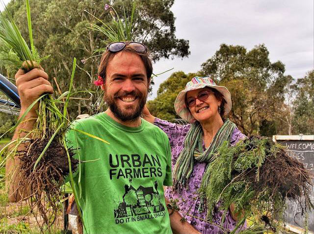 Steven Hoepfner and Jane Mowbray sample the produce at Walyo Yerta Community Garden, Adelaide.