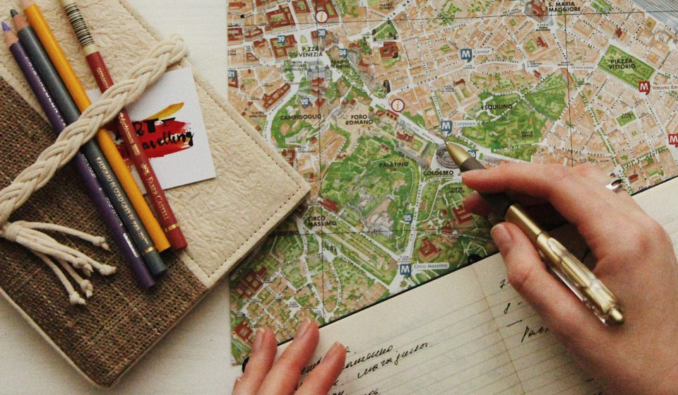 Image showing someone planning a solo travel trip