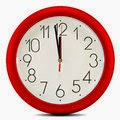 wall clock set to two minutes before midnight