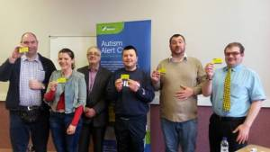 Caption: Members of Bournemouth Drop In Group receive the first Autism Alert Cards for Bournemouth, Dorset & Poole from Bob Lowndes, Chief Executive of Autism Wessex L-R: Steve Davis, Anna Goulder, Bob Lowndes, James Hall, Michael Cripps, Ollie Gray.