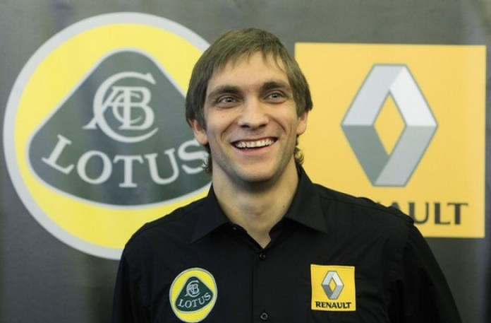 Renault Formula One driver Petrov of Russia smiles during a news conference in Moscow
