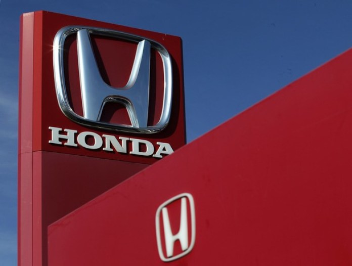 The Honda logo is seen on the forecourt of a car dealer in Brighton
