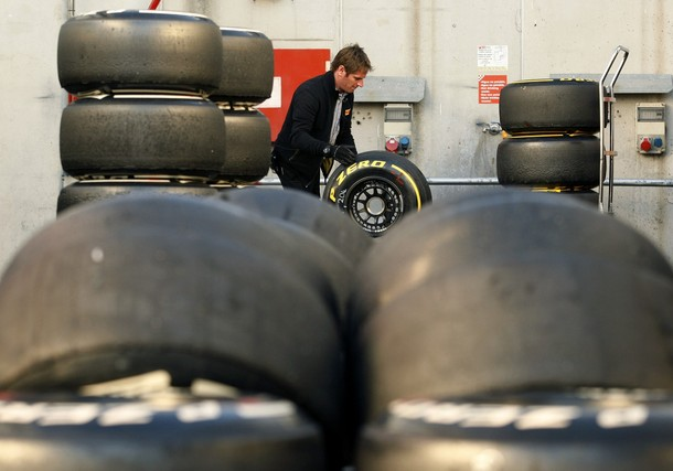 Pirelli's staff work with tyres in the paddock during a training session at Circuit de Catalunya racetrack