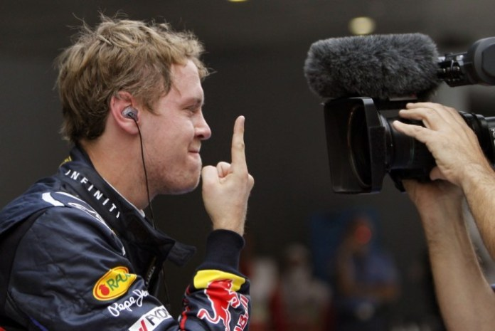 182728-red-bull-formula-one-driver-vettel-gestures-for-a-tv-camera-after-the-