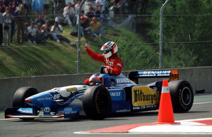michael-schumacher-giving-a-lift-to-jean-alesi-after-alesis-first-and-only-f1-win-1995-canadian-gp