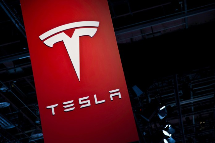 tesla-brand-logo-at-the-2014-detroit-show