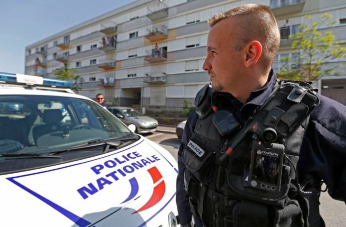 A French policeman is equipped with a personal video recorder during a patrol in the Neuhof neighbourhood of Strasbourg