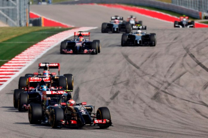 Circuit of the Americas, Austin, Texas, United States of America. Sunday 2 November 2014. Pastor Maldonado, Lotus E22 Renault, leads Jean-Eric Vergne, Toro Rosso STR9 Renault, and Romain Grosjean, Lotus E22 Renault. World Copyright: Alastair Staley/Lotus F1. ref: Digital Image _79P1467