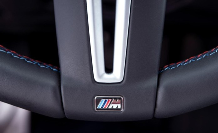 2015-bmw-m4-coupe-steering-wheel-badge-and-stitching-photo-606363-s-1280x782