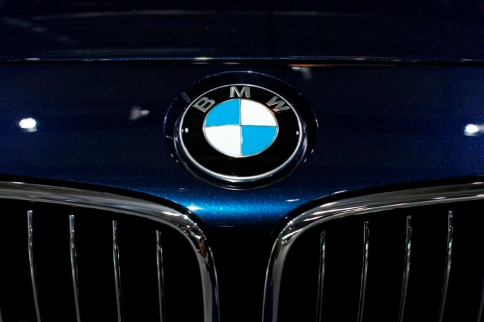 A BMW logo is seen on a car displayed on media day at the Paris Mondial de l'Automobile