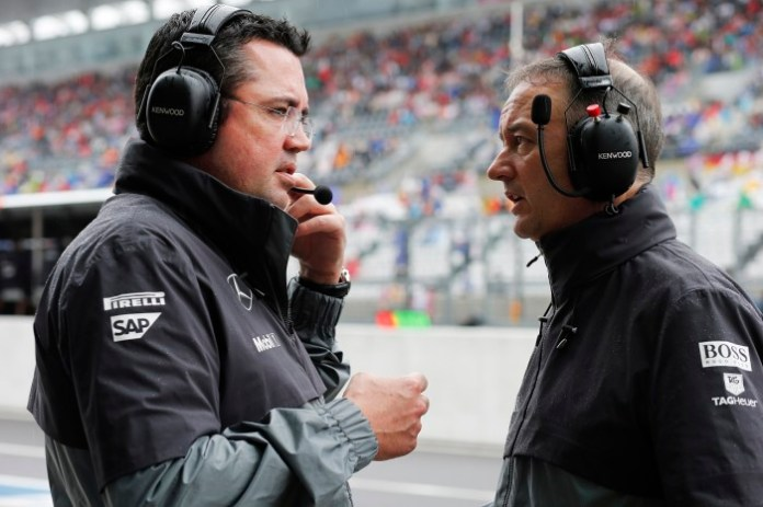 Eric Boullier with Jonathan Neale.