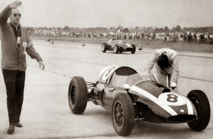 Jack Brabham pushing the car