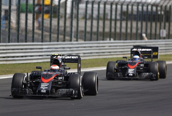 Jenson Button and Fernando Alonso on track.