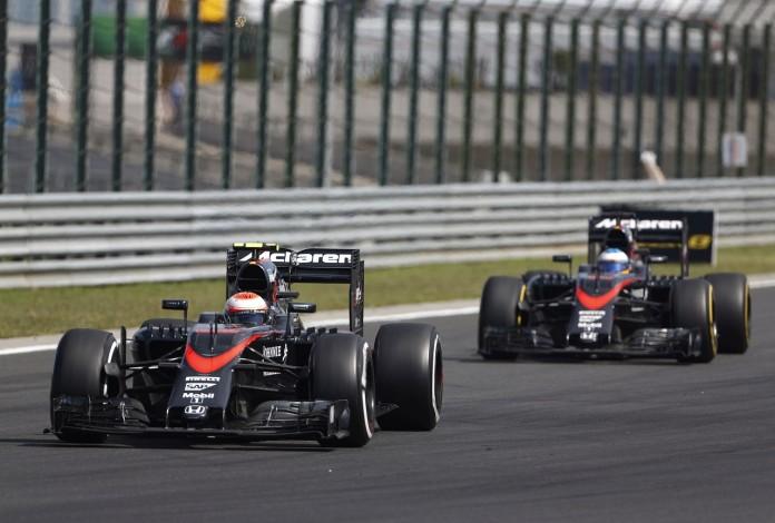 Jenson Button and Fernando Alonso on track.