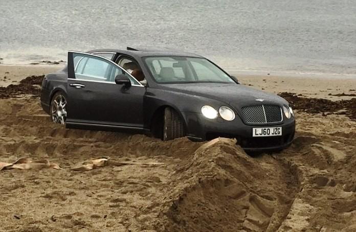 Bentley stuck on a beach
