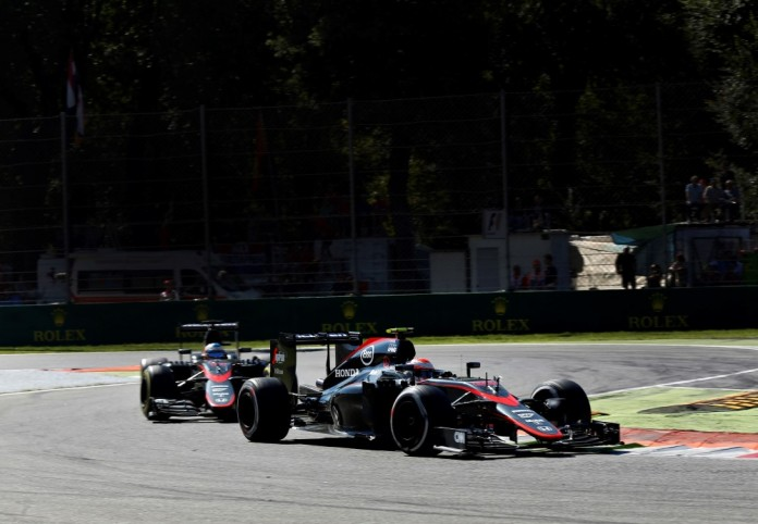 Jenson Button leads Fernando Alonso on track.