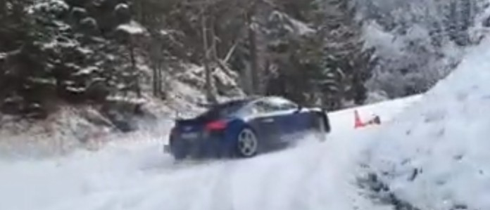 audi-r18-v10-plus-drifting-on-snowy-mountain-road-gets-lamborghini-huracan-camera-car-video-103400_1