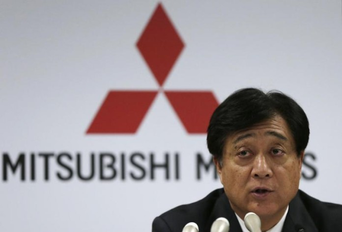 Mitsubishi Motors Corp President Osamu Masuko attends a news conference at the company headquarters in Tokyo April 25, 2013. Mitsubishi Motors Corp's net profit rose 58.7 percent year-on-year to hit a record of 38.0 billion yen ($382.4 million) in the financial year ended March, helped by the yen's rapid depreciation, cost cuts and Japan's green car subsidies. REUTERS/Toru Hanai (JAPAN - Tags: BUSINESS TRANSPORT)