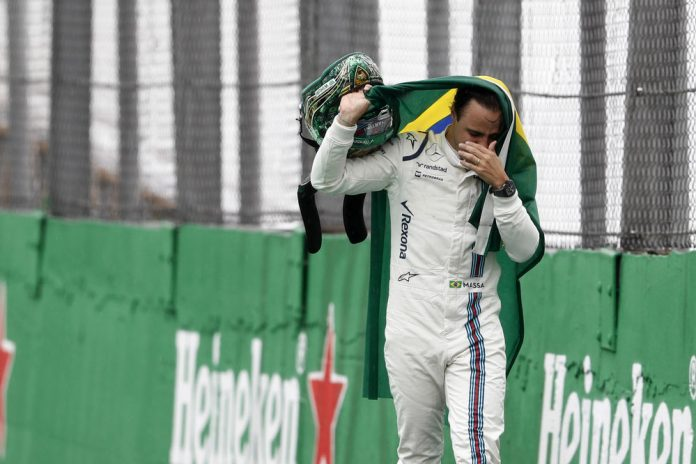 Interlagos, Sao Paulo, Brazil. Sunday 13 November 2016. An emotional Felipe Massa, Williams Martini Racing, makes his way back to the garage after retiring from the race. Photo: Glenn Dunbar/Williams ref: Digital Image _X4I7893