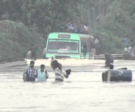 Bus driving through the water